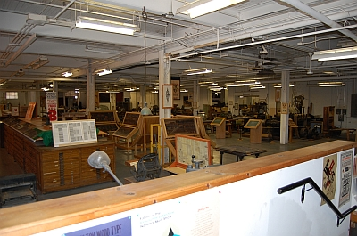 Vast floorspace holding type, production machinery and printing presses.